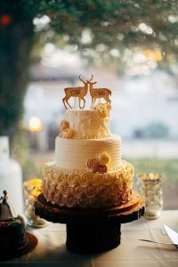wedding cake with deer and doe topper