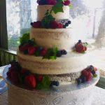 Wedding cake with fresh berries by Rita