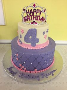 purple pink and white cake with princess tiara