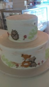 two tiered cake with forest creatures