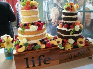 two cakes display one vanilla one chocolate with life is sweet message