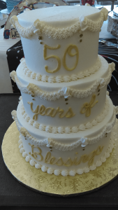 white and gold 50th anniversary cake