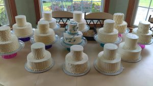 table full of white two tier cakes