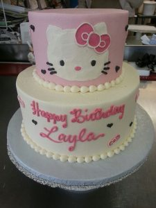 white and pink hello kitty birthday cake