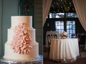elegant wedding cake with creme pink blossom on one side