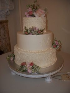 delicate wedding cake with roses