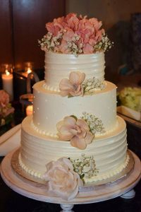 tiered wedding cake with blush rose flowers