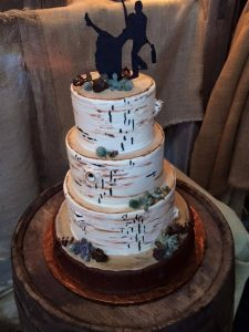 Birch tree wedding cake with shilouete bride and groom topper