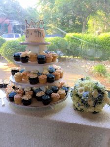 cup cake stand with wedding cake and monogram topper