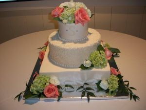 three tier square and round wedding cake with roses