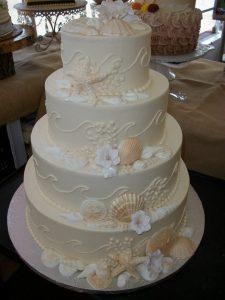 all white beach themed wedding cake