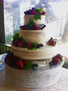 wedding cake with delicate details and berries