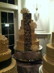 tall wedding cake with chocolate lace details