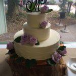Custom monogram wedding cake by Desserts by Rita