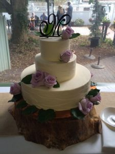 elegant three tier wedding cake with chocolate monogram topper