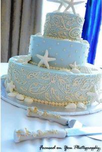 light blue wedding cake with sea stars and seashells