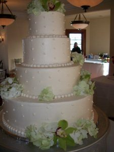 four tier wedding cake with pale lime flowers
